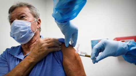Droves of volunteers have already signed up to participate in the clinical trials for these vaccines. (Credit: Marco Bello, Reuters)